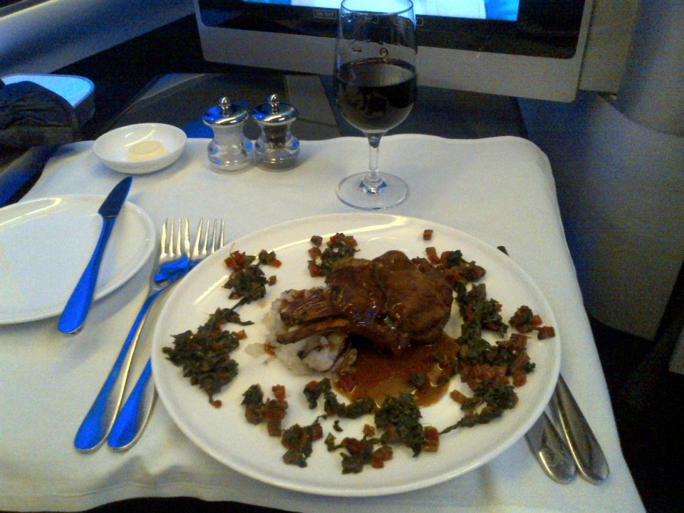Braised Petite rack of veal with demi-glace, swiss chard and rissotto with radicchio and parmesan — at British Airways Boeing 747.